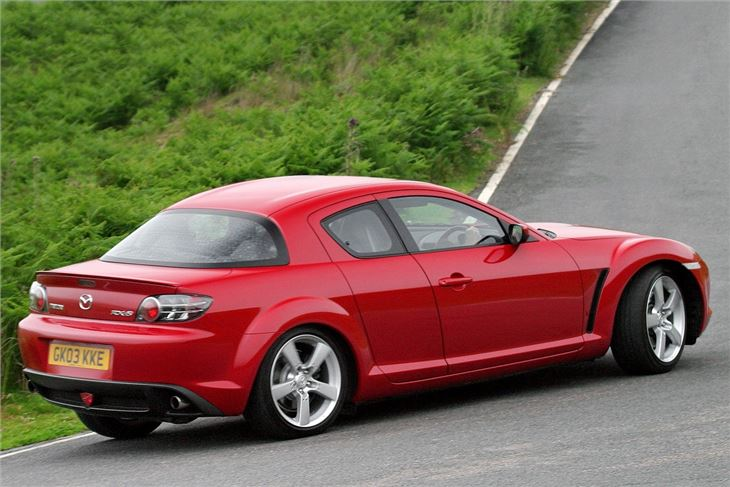 mazda rx8. itu0027s extremely easy to pop open a back door chuck briefcase in the rear footwell or lay your jacket on seat not gimmick for show mazda rx8